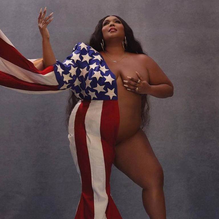 Lizzo Sends Inspiring Election Day Message While Posing Nude With an American Flag