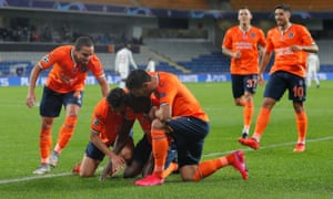 Istanbul Basaksehir players celebrate Demba Ba's opening goal against Manchester United.