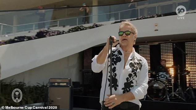 Melbourne Cup: Jon Stevens performs Never Tear Us Apart to empty Flemington Racecourse
