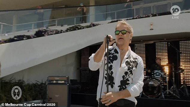 Pre-race entertainment: Jon Stevens performed an emotional rendition of the classic INXS song Never Tear Us Apart at the Melbourne Cup on Tuesday afternoon
