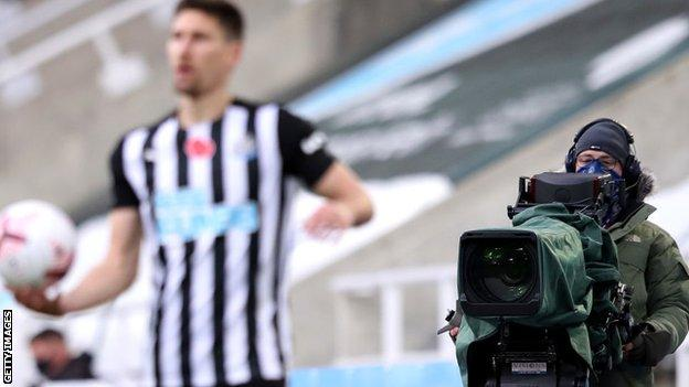 A camera focuses on a Newcastle player