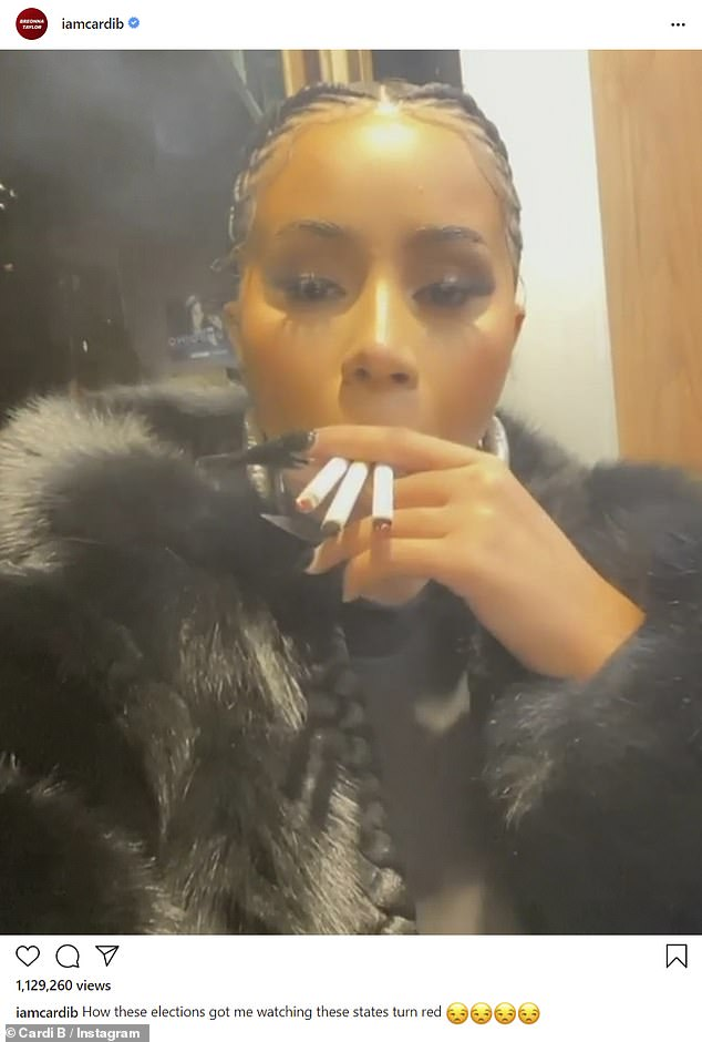 Smoking too much: Cardi B, 28, was smoking on multiple cigarettes to cope with election night stress on Tuesday, as she joined Emily Ratajkowski and other stars watching the early returns