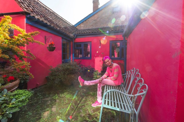 Mary Rose Young artist and ceramicist for The Metro outside her pink house