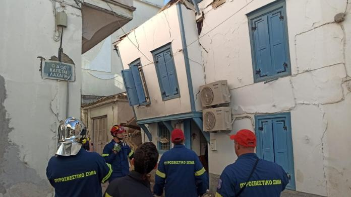 Greek firefighters inspect damaged buildings on the island of Samos.
