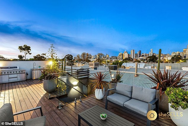 Breathtaking: The home's stunning rooftop terrace has a built-in barbecue