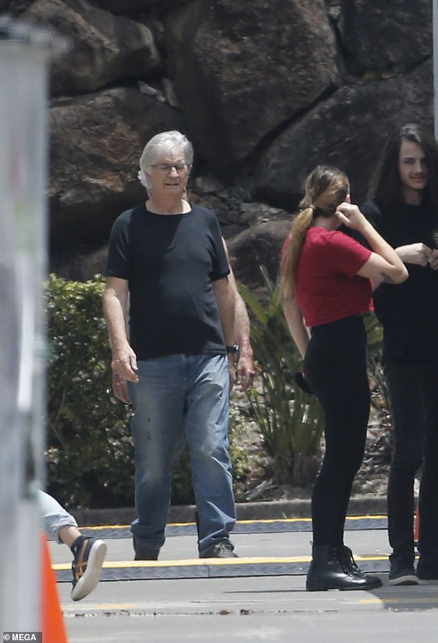 Familiar face: John Jarratt - who is known for roles including Wolf Creek and Picnic at Hanging Rock - wore faded jeans with a black T-shirt