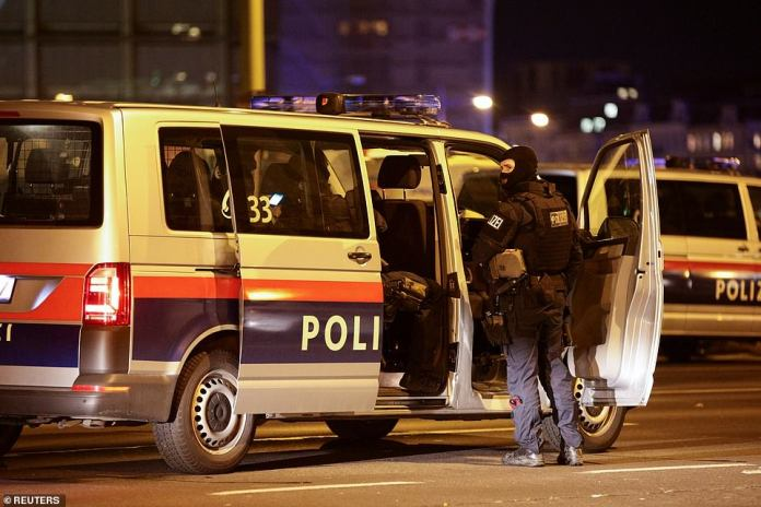 Police vehicles block a street near Schwedenplatz square after exchanges of gunfire in Vienna. A large part of central Vienna is closed off
