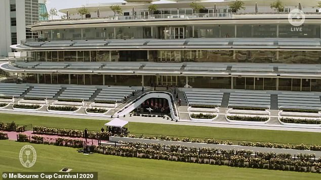 Empty venue: Due to COVID-19 restrictions on mass gatherings, no one was in the crowd at Flemington Racecourse to sing along with him, resulting in a surreal performance