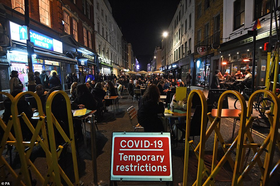People out on Old Compton Street in London, ahead of a national lockdown for England from Thursday at midnight