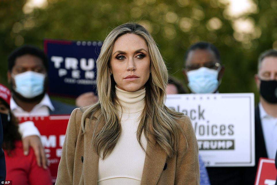 Trump's daughter-in-law Lara listens as Giuliani and her husband Eric speak Wednesday