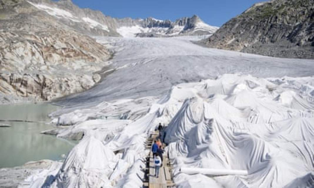 Under wraps: parts of the Rhone glacier are covered in blankets above Gletsch near the Furkapass to prevent it from melting so quickly.