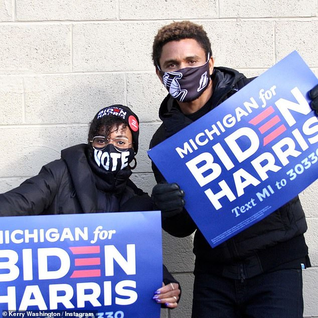 Vote mask:She also wore a black Biden-Harris stocking cap and glasses with gold hoop earrings and a black face mask that simply said VOTE in big white letters