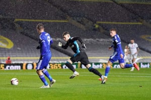 Leicester City's Jamie Vardy assists Harvey Barnes for the opening goal.