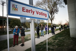 Voters wait in line to cast their ballots with social distance on the final day of early voting for the 2020 presidential election on November 2, 2020 in Cedar Rapids, Iowa.