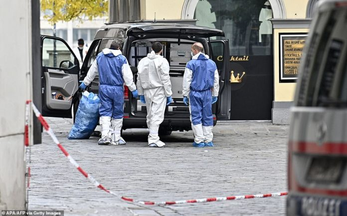 Police officers investigate near Schwedenplatz square in the center of Vienna on Tuesday morning
