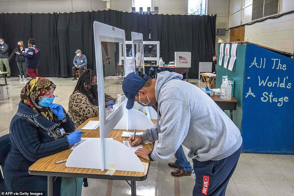 CHARLOTTE, NORTH CAROLINA: Voters check in at First Ward Elementary School in Charlotte, North Carolina shortly after the polls opened on Election Day