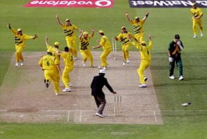 South Africa's Allan Donald (in green, right) seconds after being run out against Australia in the Cricket World Cup semi-final in 1999.