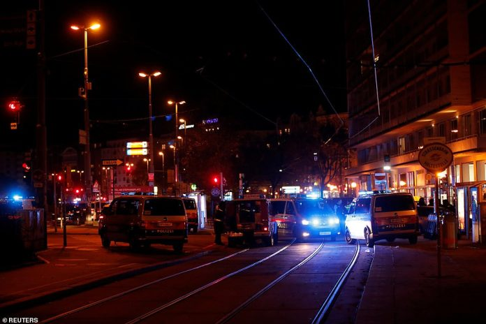 Police block a street near Schwedenplatz square after a shooting in Vienna, Austria this evening, with at least one person dead