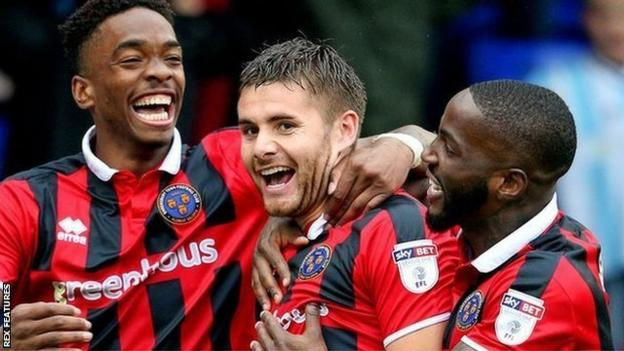 Joe Riley (centre) celebrates scoring for Shrewsbury Town in a League One win at Old Athletic on 3 September 2016