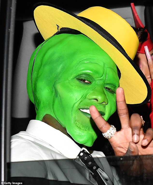 The Mask: Offset gave a glimpse at his costume in the light as he was pictured pulling out in a black SUV with Cardi