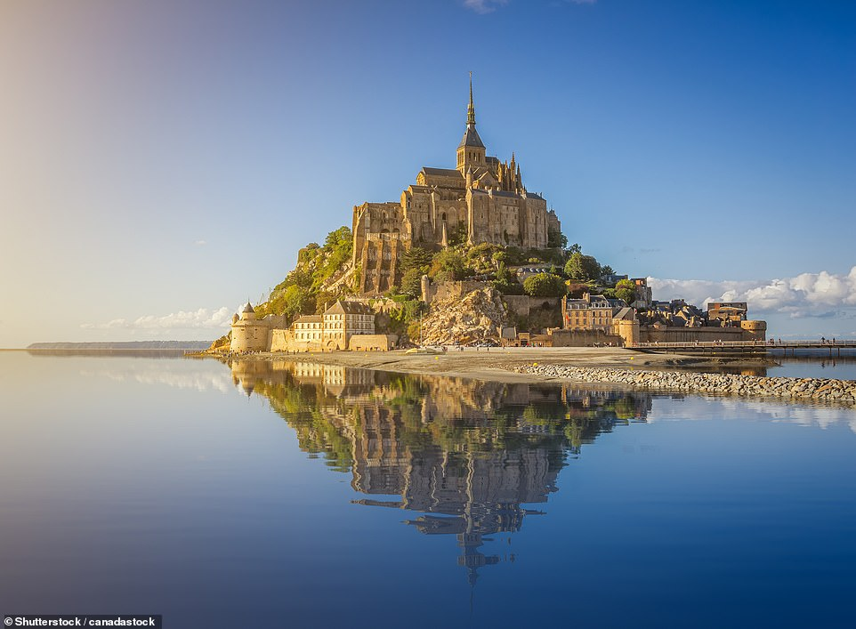 33. MONT SAINT-MICHEL, FRANCE: This tidal island with its Gothic abbey is off the coast of Normandy and Big 7 Travel says it is the 'epitome of spellbinding beauty'