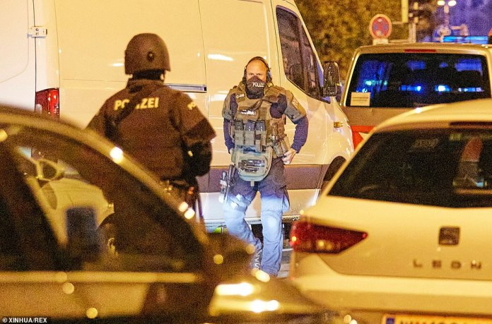 Heavily armed police on the streets of Vienna last night after a terror attack which left four dead