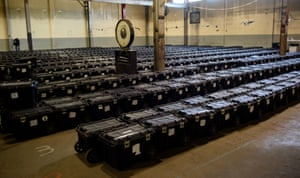 Election precinct suitcases containing ballots, election materials and keys to voting machines are held under guard by the Allegheny County Police at the Allegheny County elections warehouse on November 4, 2020 in Pittsburgh, Pennsylvania.