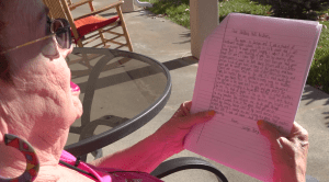 Holiday Hills resident, Lynette, reads a letter