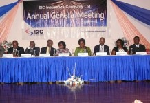 Board members at the SIC Insurance Company at the AGM