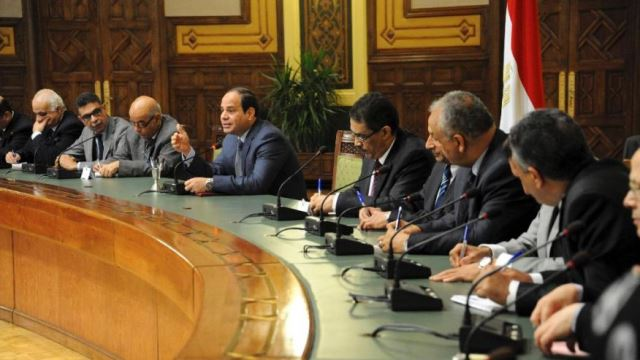 In this photo provided by Egypt's state news agency MENA, Egyptian President Abdel-Fattah el-Sissi, center, meets with editors of Egyptian newspapers and media in the presidential palace, in Cairo Egypt, Sunday, Aug. 24, 2014. El-Sissi denied Sunday any military involvement in neighboring Libya, a day after Islamist militias accused Cairo of bombing their posts in Tripoli, Egypt's state news agency reported. El-Sissi said Egypt is in consultation with Libya's neighbors to find a political solution to the violent power struggle between rival groups. (AP Photo/MENA)The Associated Press