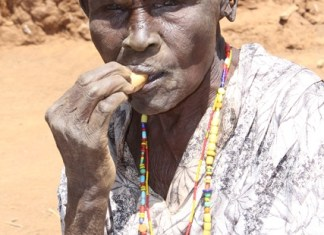 An old woman is seen outside her mud-house in Baringo, northwest Kenya, March 12, 2015. Residents of Baringo County are experiencing extreme cases of hunger as a result of the long periods of drought in Kenya. According to Kenya's Devolution Cabinet Secretary Anne Waiguru, a total of 1.6 million people in arid and semi-arid parts of Kenya are in danger of dying as a result of hunger. (Xinhua/Simbi Kusimba)