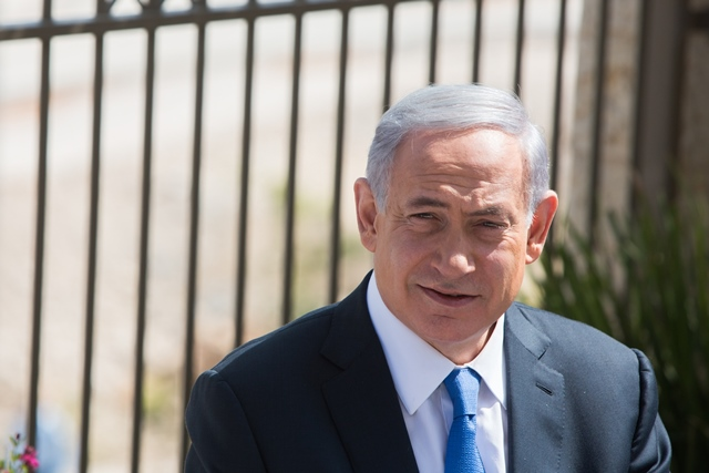 """Israeli Prime Minister Benjamin Netanyahu attends a campaign trail in the east Jerusalem Jewish settlement of Har Homa, on March 16, 2015. Israeli Prime Minister Benjamin Netanyahu told an Israeli news website Monday that if he is elected in Tuesday's national elections, """"there will be no Palestinian state."""" (Xinhua/JINI)"""