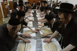 Ultra-Orthodox Jews make matzo for the upcoming Jewish holiday of Passover at a bakery in Rechovot, central Israel, on March 23, 2015. Matzo is an unleavened bread traditionally eaten by Jews during the week-long Passover holiday, when eating chametz, bread and other food made with leavened grain, is forbidden according to Jewish religious law. Passover is an important Biblically-derived Jewish festival. The Jewish people celebrate Passover as a commemoration of their liberation over 3,300 years ago by God from slavery in ancient Egypt that was ruled by the Pharaohs, and their freedom as a nation under the leadership of Moses. (Xinhua/Gil Cohen Magen)