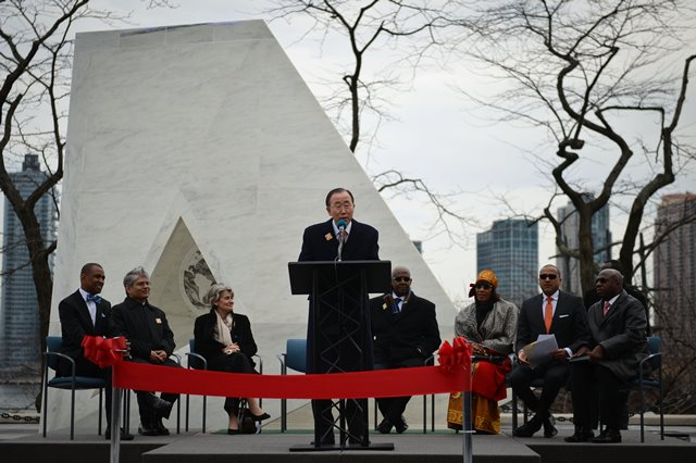 UN Secretary-General Ban Ki-moon (C) speaks during the unveiling ceremony of a permanent memorial named