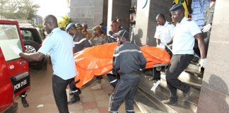 Rescue team members carry out a body of a victim from the Radisson Blu hotel in Bamako, Mali, Nov. 20, 2015. Three Chinese citizens were killed in a hostage-taking situation at the Radisson Blu hotel in the Malian capital, while four other Chinese citizens were rescued, the Chinese Embassy in Mali confirmed to Xinhua on Friday. (Xinhua/Stringer)