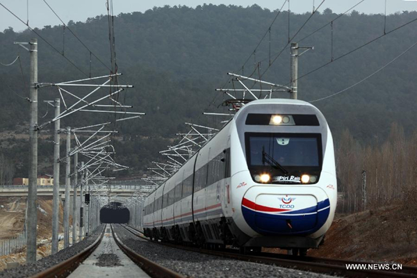 A trial train takes a test run on the Ankara-Istanbul high-speed railway constructed by China Railway Construction Corporation Limited (CRCC) in Turkey on Jan. 4, 2014. [Photo/Xinhua]