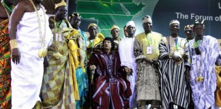 Libyan leader Muammar el-Qaddafi poses for the camera during a meeting with kings, princes, sultans and the sheikhs of various tribes of Africa in Benghazi on August 28, 2008.