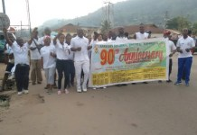 Dr Kwame Anim Boamah,Medical Director of the Koforidua Regional Hospital in the middle holding the banner, with some of the staff of the Hospital