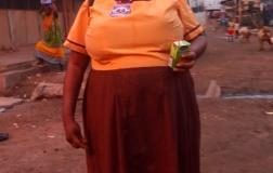 Ms Janet Manu in her school uniform, and a kalyppo drink in hand.