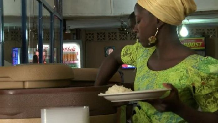 Woman serves rice in a cafe
