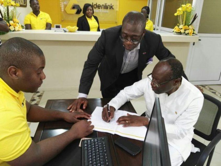 Finance Minister Ken Ofori-Atta opening an account