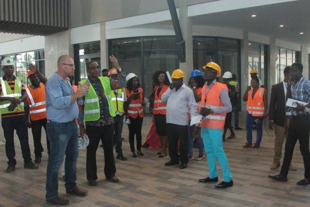 Mr. Gerber explains a point to Mr. Kofi Sekyere during the facility visit of the Kumasi media