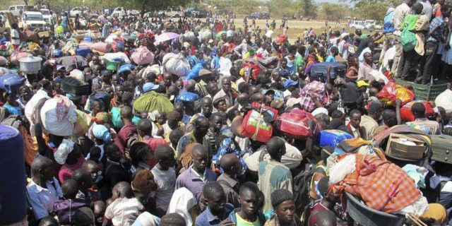 In this photo taken Wednesday, Dec. 18, 2013 and released by the United Nations Mission in South Sudan (UNMISS), civilians fleeing violence seek refuge at the UNMISS compound in Bor, capital of Jonglei state, in South Sudan. Less than three years after its creation, the world's newest country is beginning to fracture along ethnic lines in violence that has killed hundreds of people and what could come next, some warn, is ethnic cleansing. (AP Photo/UNMISS, Hailemichael Gebrekrstos)