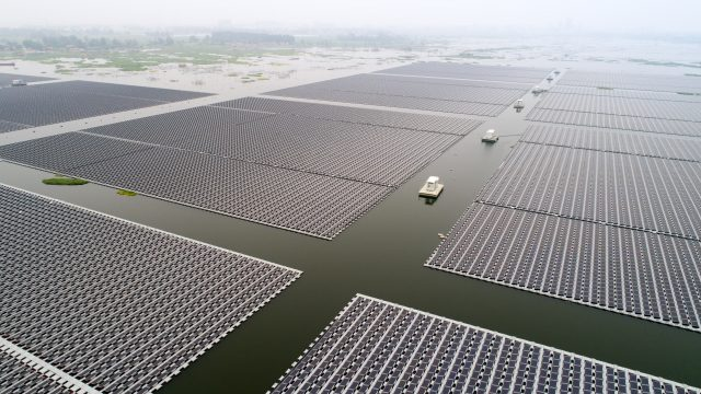 Photo taken on June 22, 2017 shows the PV power station floating on waters of the coal mining subsidence area in Huainan City, east China's Anhui Province. (Xinhua/Guo Chen)