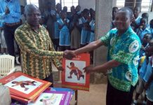 Mr. Anthony Amoah (R) presenting the books to Mr. Samuel Duame (L)