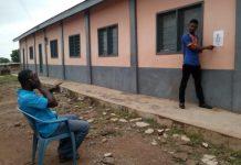 Mr. Moses Kombat a Nurse at the HFH screening a client at Nsuta, Techiman