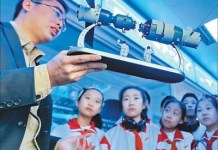 A staff from a radio administration bureau teaches students the application of radio in aerospace industry. An activity about space knowledge was held for students of a primary school in Qinhuangdao, north China's Hebei province in April, 2017. (Photo by Shi Ziqiang from People's Daily)