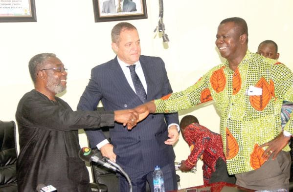 Dr Anthony Nsiah-Asare (left) exchanging pleasantries with Dr Baffour Awuah, Special Advisor to the Minister of Health, after the launch. With them is Mr Joao Paulo Magalhaes (middle), the Country Manager, Roche Product Ghana. Picture: EDNA ADU-SERWAA