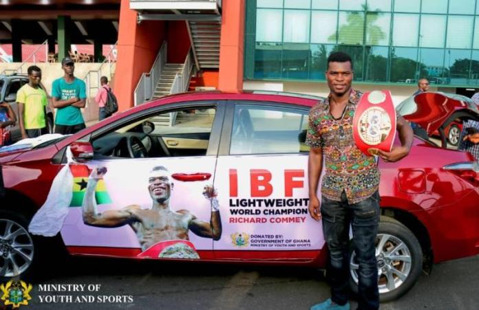 Moys Presents Car To Richard Commey