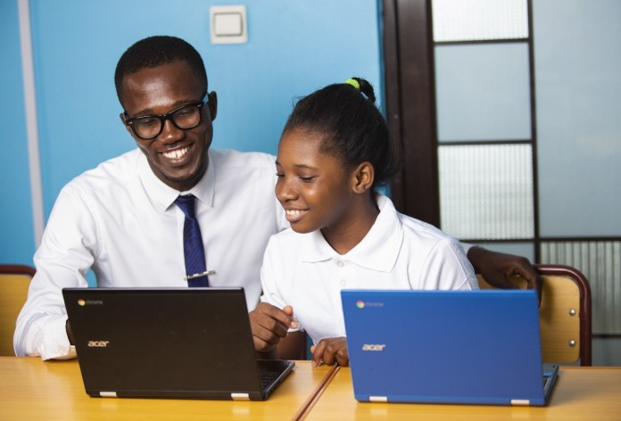 A Vine Christian High School Facilitator guiding a student in Class